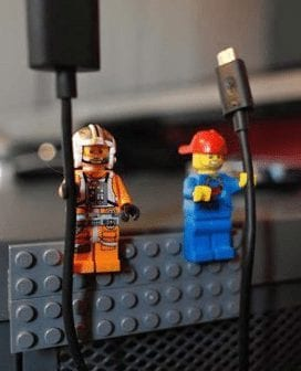Two lego figures used as cord holders.