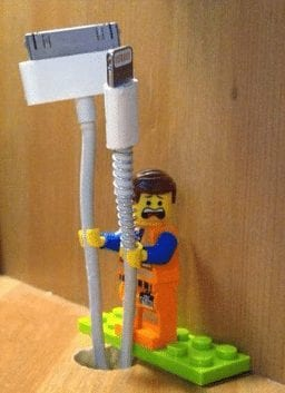 One lego mini figure used as a cord holder.