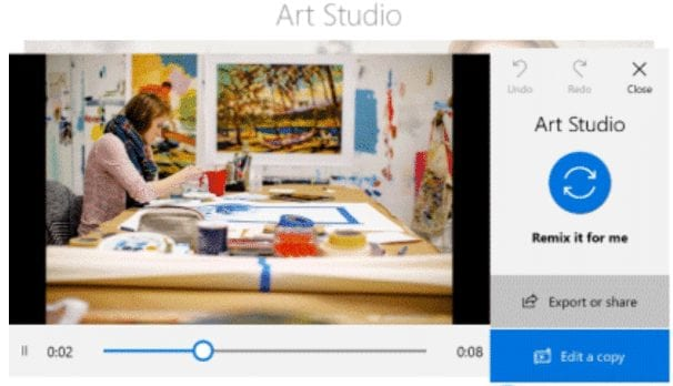 Designer creating a video from still photos using Microsoft Windows video remix feature