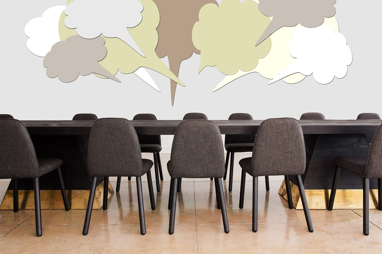 Presentation room with speech bubbles. When someone mentions you in a Microsoft Office 365 comment, you'll receive an email notification. The email includes a link that takes you to the comment in the document or presentation.