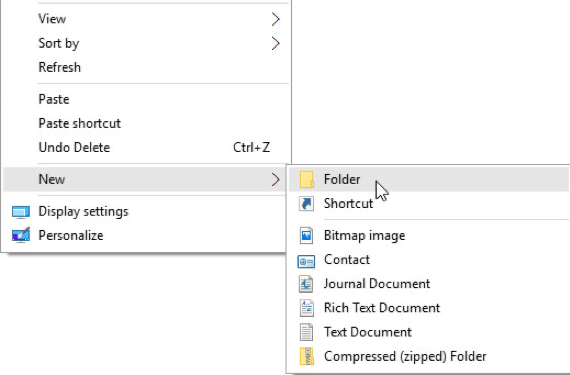 To declutter your PC's desktop in Windows 10, create a new folder and then drag and drop any desktop icon into the new folder to hide it from view.
