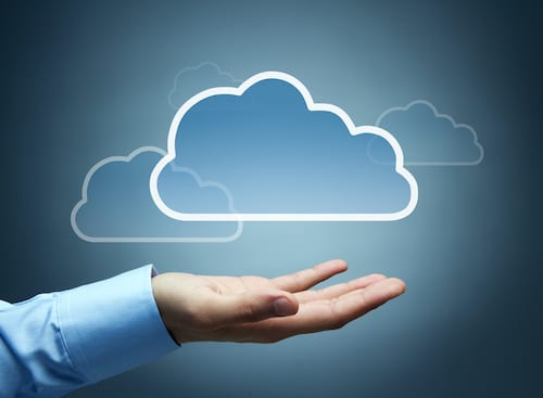 Business leader's hand beneath a cloud, symbolizing Cloud Solution Provider (CSP) licensing.