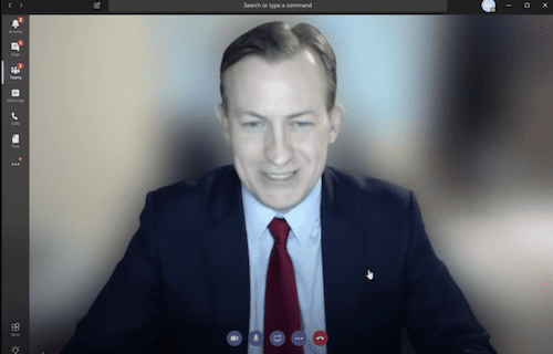 Presenter in a Microsoft Teams meeting with a blurred background.